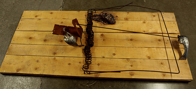 Image of human mouse trap sculpture
